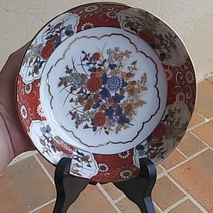 Decorative Japanese plate with a wood stand